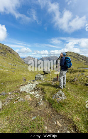 Female mountain walker high on the slopes of Blaven above Fionna Choire in the Cuillin mountains, Isle of Skye, Scotland, UK - Stock Photo