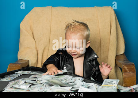 Keeping business on top. Boy child with money case. Little boy count money in cash. Small child do business accounting in startup company. Startup bus - Stock Photo