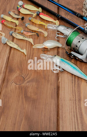 KYIV- JAN 6, 2019: Fishing tackle - fishing spinning, hooks and lures on wooden background with copy space - Stock Photo