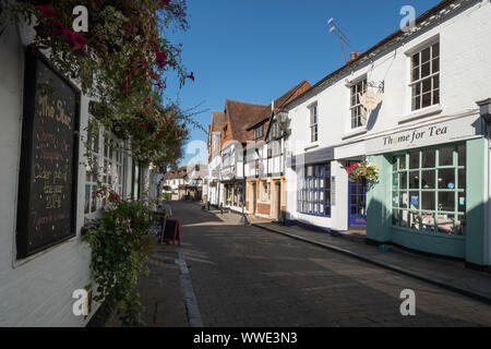 Picturesque Church Street in Godalming town centre, Surrey, UK, with the Star Inn, tea rooms and shops - Stock Photo