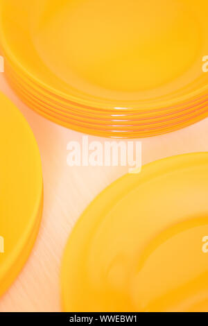 orange plates in a wooden box close up - Stock Photo