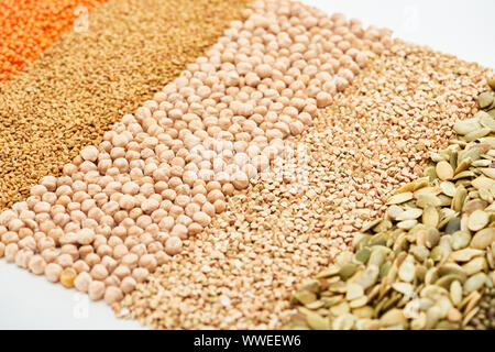 raw green buckwheat, chickpea, lentil and pumpkin seeds isolated on white - Stock Photo