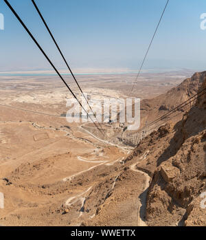 Looking Down on the on the Starting Point for the Cable to Masada with Dead Sea in the background - Stock Photo