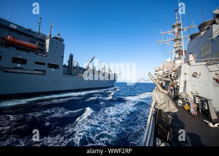 MEDITERRANEAN SEA (Sept. 9, 2019) — The Lewis and Clark-class dry-cargo ship USNS Medgar Evers (T-AKE 13) conducts a replenishment-at-sea with the Arleigh Burke-class guided-missile destroyer USS Porter (DDG 78) in the Mediterranean Sea Sept. 9, 2019. Porter, forward-deployed to Rota, Spain, is on its seventh patrol in the U.S. 6th Fleet area of operations in support of U.S. national security interests in Europe and Africa. (U.S. Navy photo by Mass Communication Specialist 3rd Class T. Logan Keown/Released) - Stock Photo