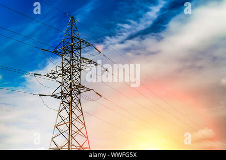 Power transmission line sunset landscape, nice background for presentation about Energy technology or industry. Copy space for your text Stock Photo