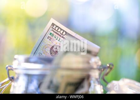 American banknote in glass jar.