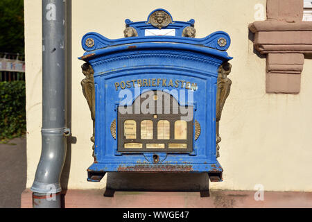Heidelberg, Germany - September 2019: Official replica of a blue historical public post mail box from 1896 - Stock Photo
