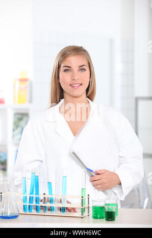 young woman in a laboratory - Stock Photo