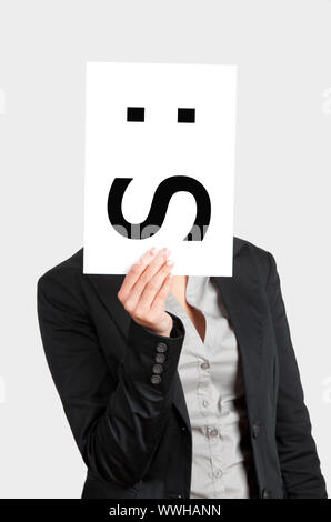 Woman showing a blank paper with a confused emoticon in front of her face - Stock Photo