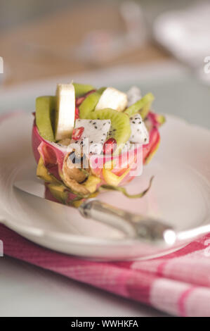 halved pitahaya with fruit salad - Stock Photo