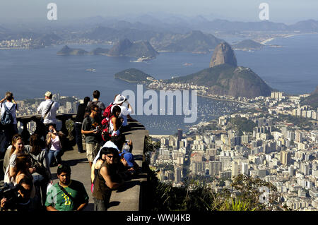 Tourists enjoying view from Corcovado in Rio de Janeiro - Stock Photo