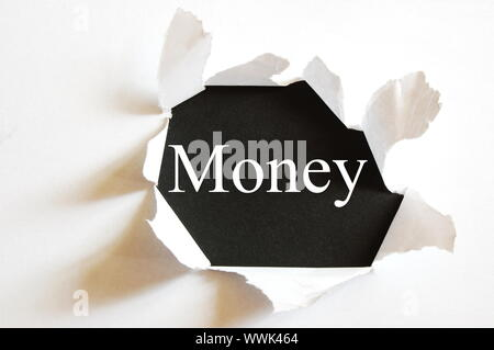 money concept with hole in paper and black background - Stock Photo
