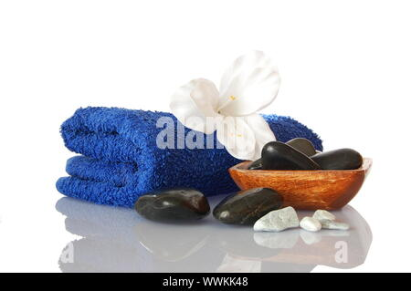 spa still life with towel and flower showing wellness concept - Stock Photo