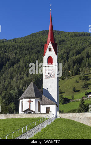 Typical South Tyrolean village church in the mountains - Stock Photo