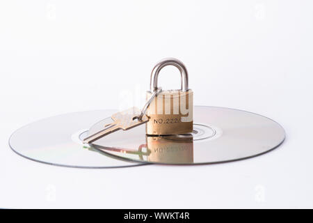 Computer disk and lock isolated on white background - Stock Photo