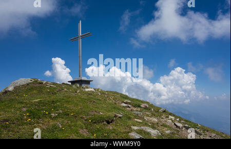 Summit cross with clouds in the background - Stock Photo