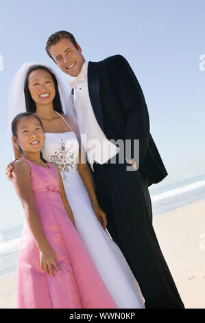 Bride and Groom With Sister on Beach - Stock Photo