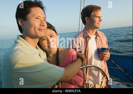 Couple with Friend on Boat - Stock Photo