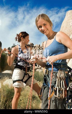 Climbers Tying Ropes Before Climb - Stock Photo