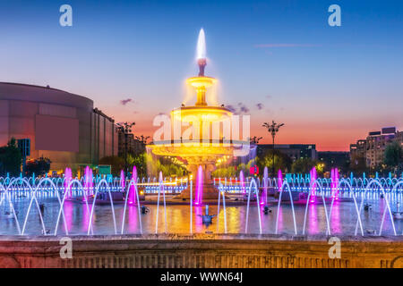 Bucharest, Romania. Water fountains at the Unirii Square. - Stock Photo