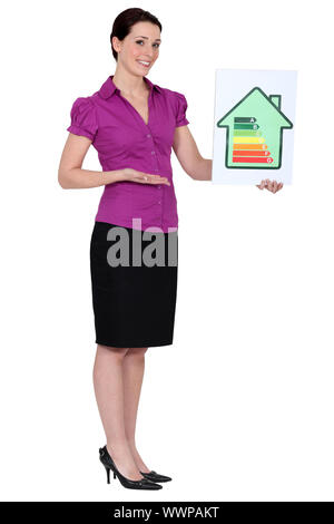 Woman holding energy rating card - Stock Photo