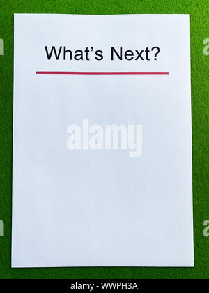 Clipboard with text what's next on green desk. - Stock Photo