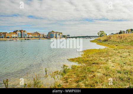 Looking back towards the town from the bank of the River Adur at Shoreham - Stock Photo