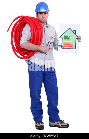 Electrician holding energy rating placard - Stock Photo