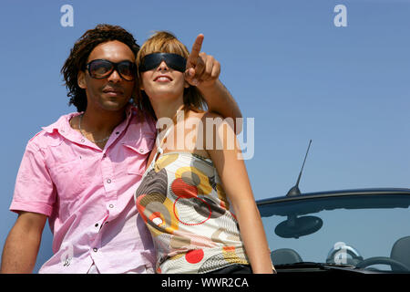 Couple stood by car trying to find destination - Stock Photo