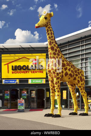 giraffe in front of Legoland at CentrO, Oberhausen, Ruhr area, North Rhine-Westphalia, Germany - Stock Photo