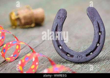 Horseshoes and champagne corks at parties as a talisman for luck - Stock Photo