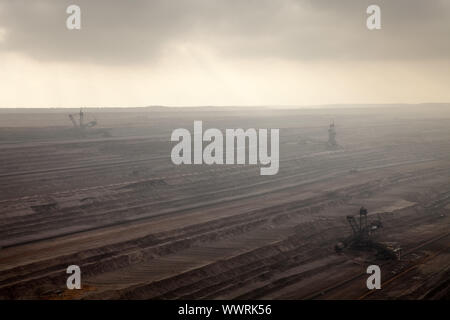brown coal surface mining Hambach with spreader and tripper car in the mist, Elsdorf, Germany - Stock Photo
