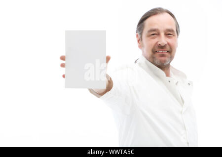 Mature man holding blank note isolated on white - Stock Photo