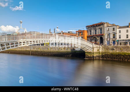 Ha'penny Bridge over the Liffey River in Dublin, Ireland - Stock Photo