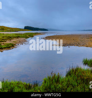 Beautiful landscape of Scotland.Moody sky with clouds and morning fog above lake in Scottish Highlands.Idyllic scenery.Nature.Wilderness. - Stock Photo