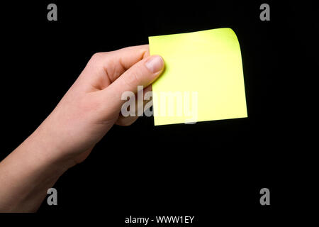 Holding a Sticky Note - Stock Photo