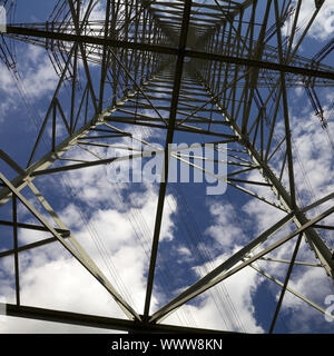 view from below to the top of a power pole, Voerde, North Rhine-Westphalia, Germany, Europe - Stock Photo