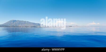 Alicante Denia view from blue calm Mediterranean sea in Spain - Stock Photo