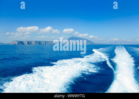 Alicante Denia view from blue Mediterranean and boat wake in Spain - Stock Photo