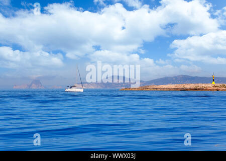 Espalmador in Formentera island with Gastabi lighthouse and Ibiza in background - Stock Photo