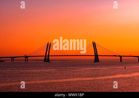 Landscape with new cable stayed bridge on orange sunset backdrop.. Western high-speed diameter, Bolshoy Obuhovskiy Bridge in Saint Petersburg. New lan - Stock Photo