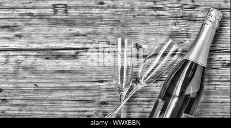 Champagne. Champagne bottle and two empty glasses on a wooden background. Valentine's Day. Birthday. - Stock Photo