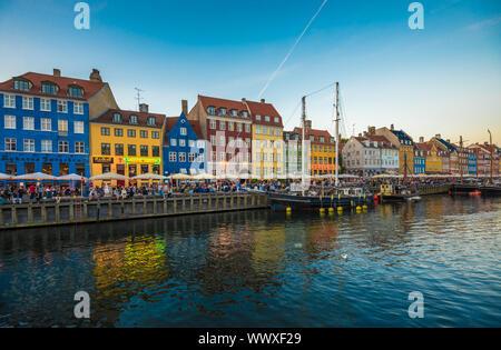 Nyhavn district is one of the most famous landmarks in Copenhagen, Denmark - Stock Photo