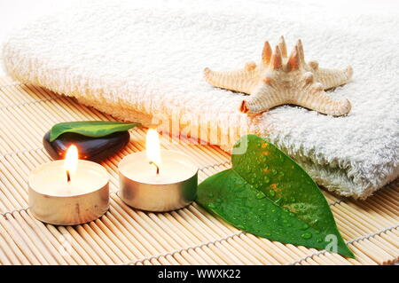 towel and zen stones showing a bath or wellness concept - Stock Photo