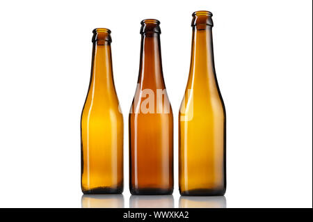 Three empty bottles of beer isolated on white background. - Stock Photo