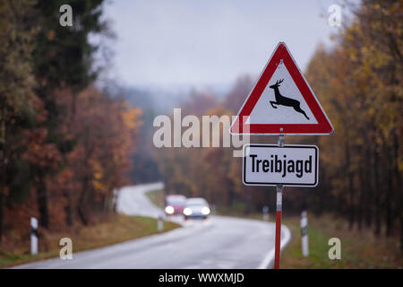 Traffic sign Treibjagd with country road - Stock Photo