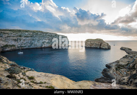 Panoramic view of Dwejra bay with Fungus Rock, Gozo, Malta - Stock Photo