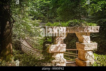 Small suspension bridge in the arboretum. - Stock Photo