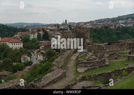 Gate tower and ruins of Tsarevets fortress with a view of the old town of Veliko Tarnovo in the background, Bulgaria - Stock Photo