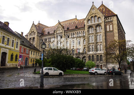 Budapest, Hungary - May 19, 2010:   National Archives of Hungary building on a rainy day. The building is located in Varnegyed (Castle Quarter) and is - Stock Photo